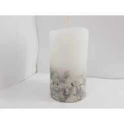 Handmade oval candle made of concrete, white with black